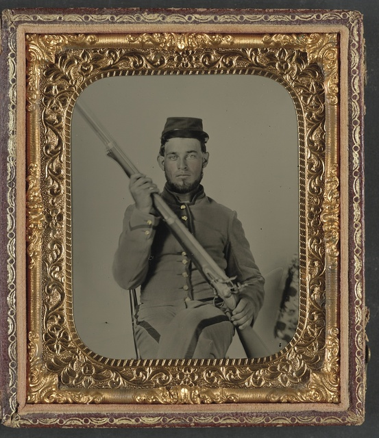 [Unidentified soldier in Confederate uniform with flintlock musket]