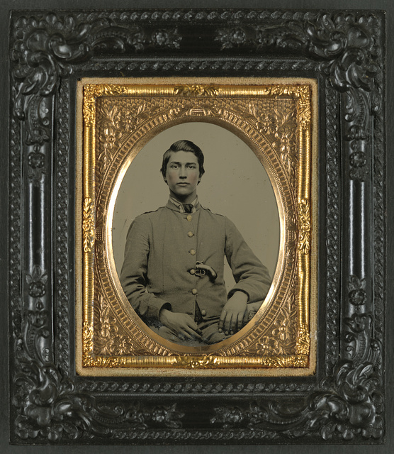 [Unidentified soldier in Confederate uniform with percussion pistol]