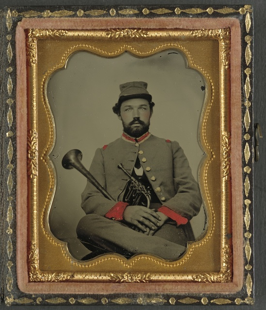 [Unidentified soldier in Confederate uniform with saxhorn]