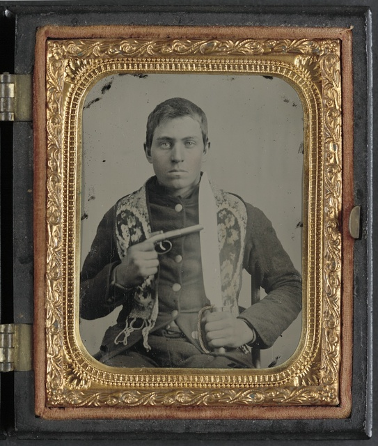 [Unidentified soldier in Confederate uniform with single shot percussion pistol and D guard Bowie knife]