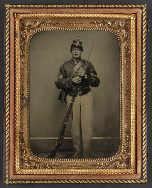 [Unidentified soldier in New York state enlistedman's uniform with bayoneted musket]