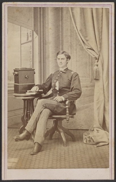[Unidentified soldier in uniform with cabinet stereograph viewer] / H. B. Hillyer's Art Rooms, Austin, Texas.