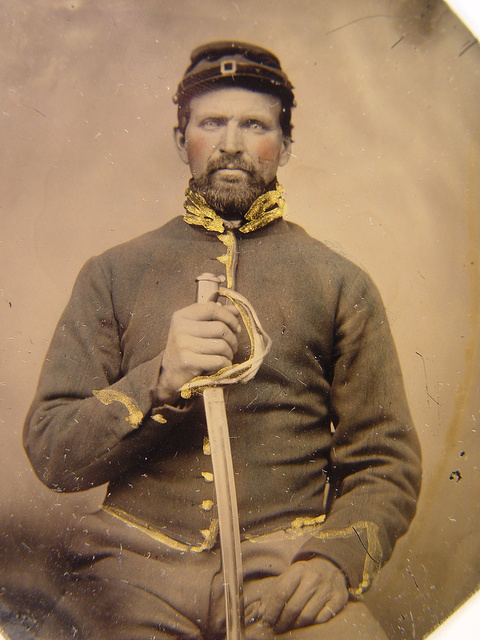[Unidentified soldier in Union cavalry uniform holding cavalry saber]