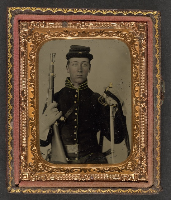 [Unidentified soldier in Union cavalry uniform with percussion cap pistol carbine, attached stock, and cavalry saber]