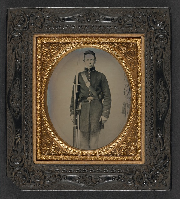 [Unidentified soldier in Union frock coat with musket and attached sword bayonet]