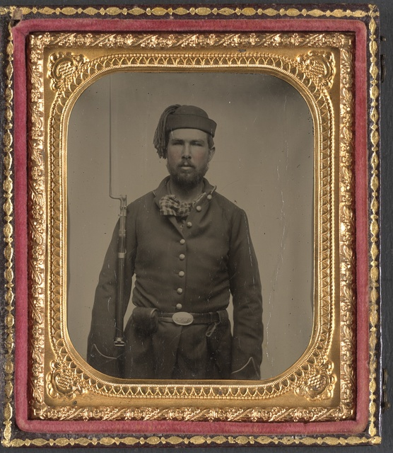 [Unidentified soldier in Union infantry uniform and Volunteer Maine Militia belt buckle with bayoneted musket] / Carleton, artist, Portland, Me.