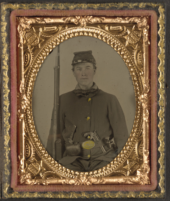 [Unidentified soldier in Union infantry uniform with rifle and 3rd Model Beals' revolver]