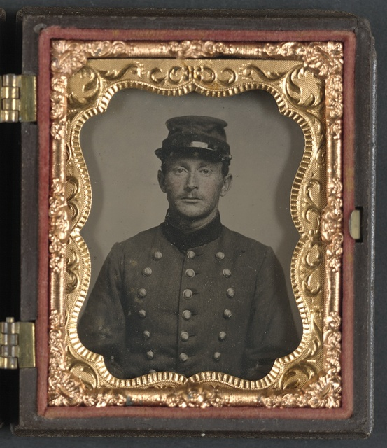 [Unidentified soldier in Union jacket with Massachusetts state seal buttons]