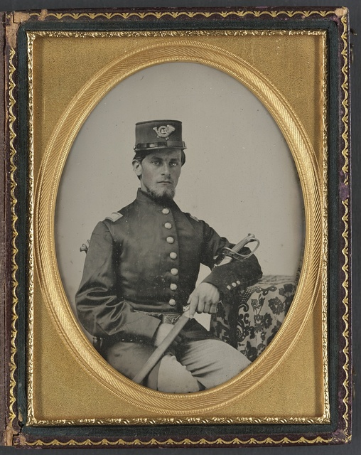 [Unidentified soldier in Union officer's uniform with sword]