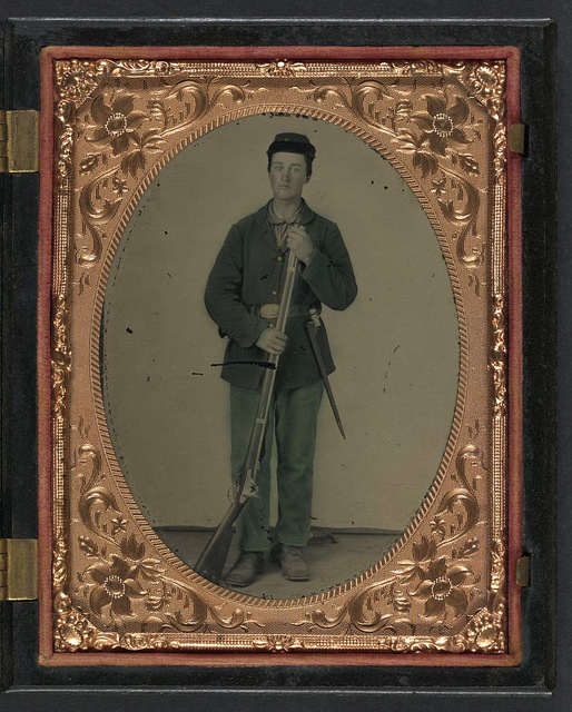[Unidentified soldier in Union sack coat and forage hat with cartridge pouch, bayonet scabbard, and musket]