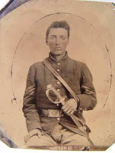 [Unidentified soldier in Union sergeant's uniform with U.S. Model 1850 officer's sword]