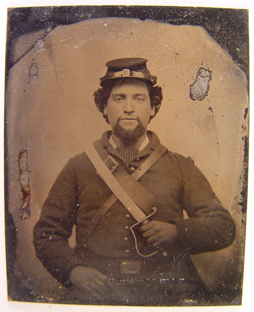 [Unidentified soldier in Union uniform and forage cap holding 1818 Nathan Starr Contract cavalry saber]