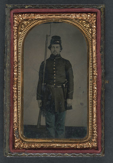 [Unidentified soldier in Union uniform and forage cap with holstered revolver and bayoneted musket]