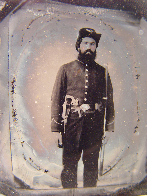 [Unidentified soldier in Union uniform and infantry Hardee hat with musket, revolver, and Bowie knife with sheath]