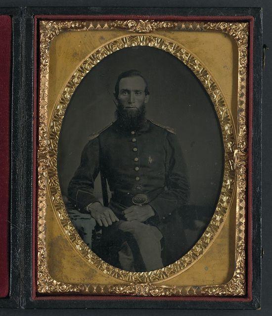 [Unidentified soldier in Union uniform and Ohio Volunteer Militia belt buckle]