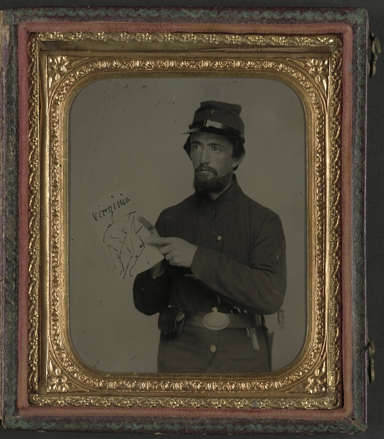 [Unidentified soldier in Union uniform and U.S. belt buckle with pistol holding hand-drawn map of Virginia]