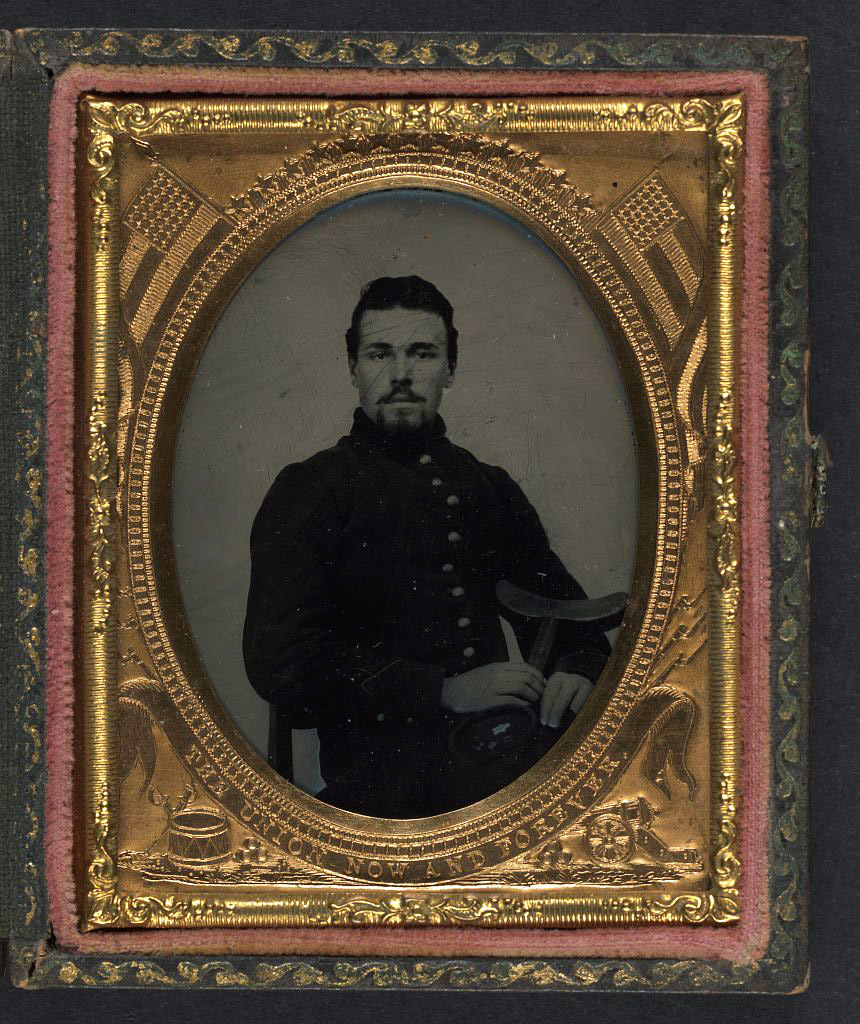 [Unidentified soldier in Union uniform holding crutch and cap]