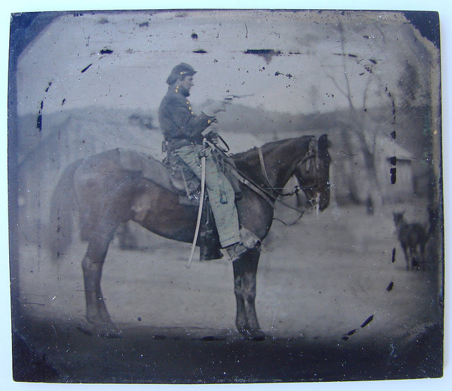 [Unidentified soldier in Union uniform sitting on horse with revolver and saber]