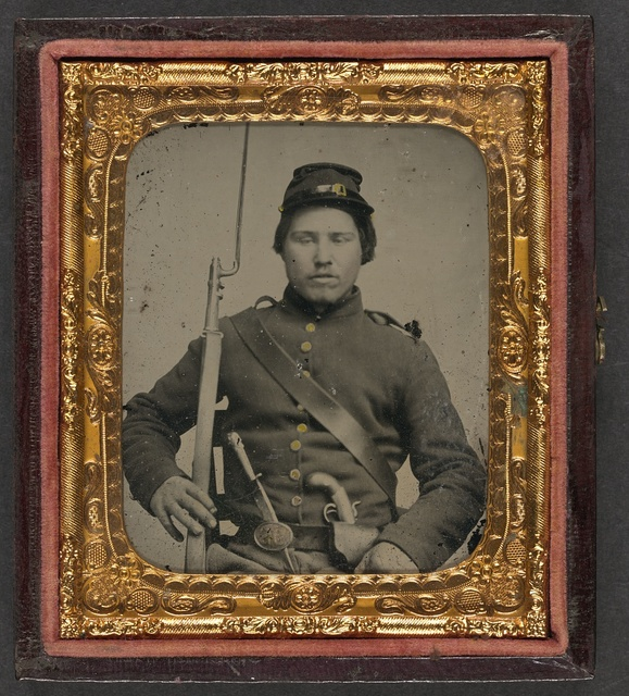 [Unidentified soldier in Union uniform with bayoneted musket, knife, and single-shot percussion pistol]