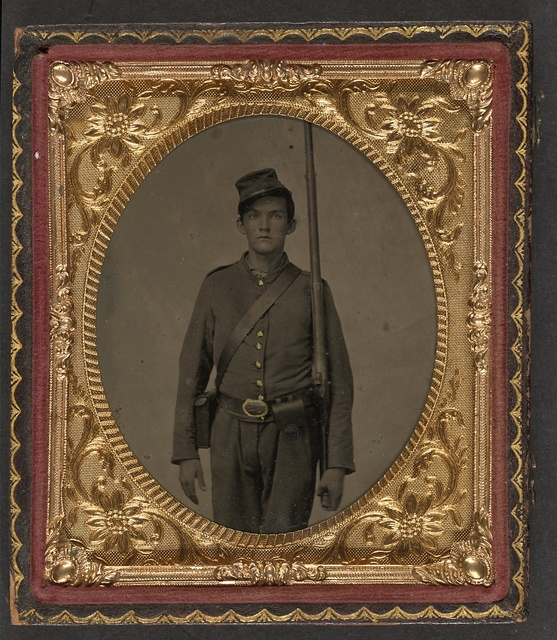 [Unidentified soldier in Union uniform with cartridge and cap boxes standing with musket]