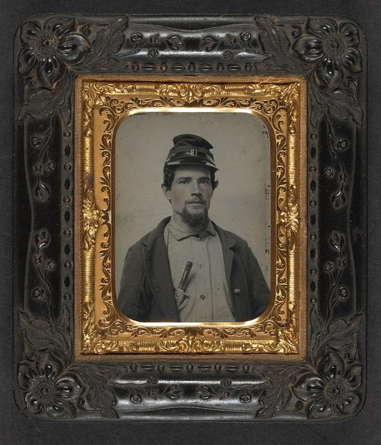 [Unidentified soldier in Union uniform with forage cap carrying a bone handle knife in breast pocket]