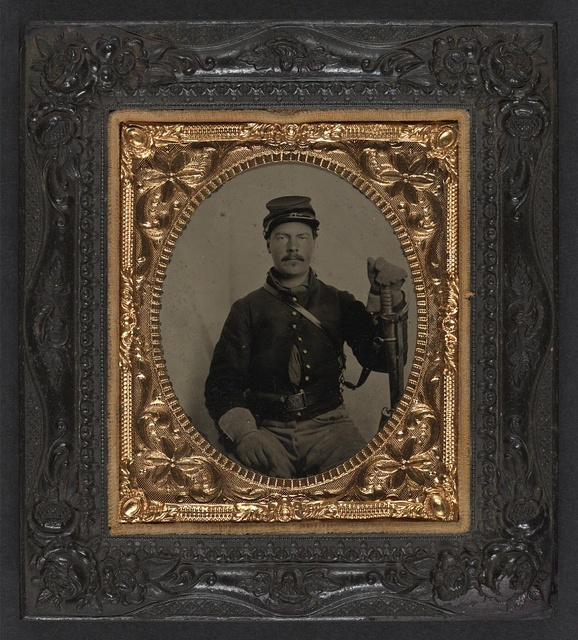 [Unidentified soldier in Union uniform with gauntlets, holstered revolver, and U.S. Model 1860 Light Cavalry saber]
