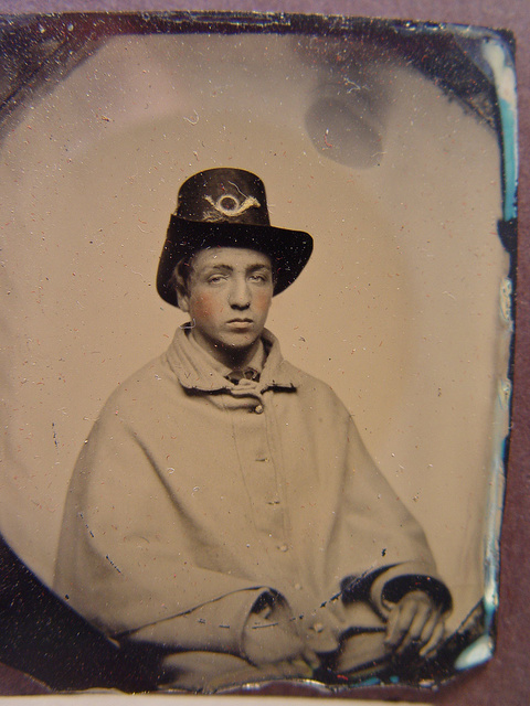 [Unidentified soldier in Union uniform with greatcoat and Hardee hat]