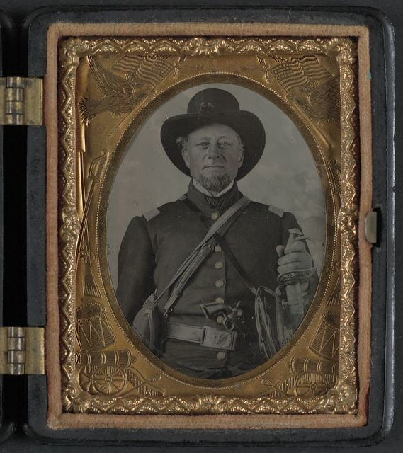 [Unidentified soldier in Union uniform with revolver, staff officer's sword, and side canteen]