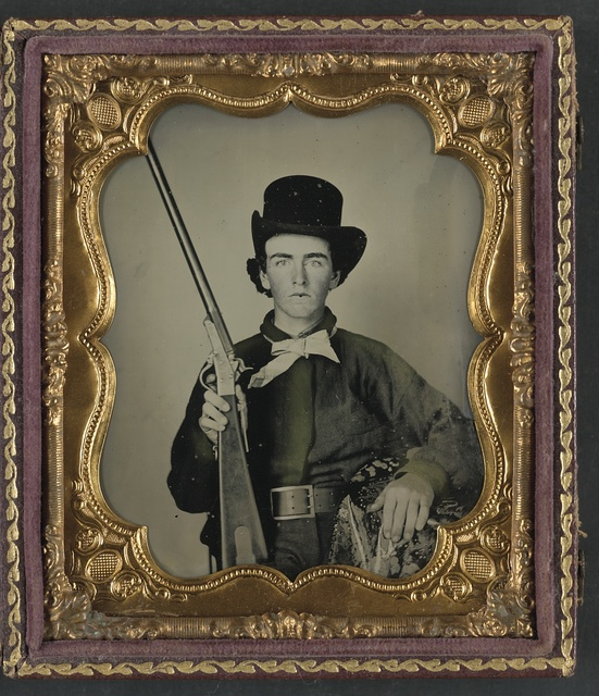 [Unidentified soldier of 1st Mississippi Cavalry Battalion in uniform and Confederate wishbone frame buckle, with 1st model Maynard carbine]