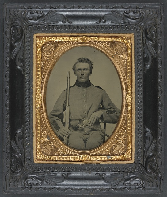 [Unidentified soldier of 8th Wisconsin Infantry Regiment, with musket, bayonet, and scabbard]