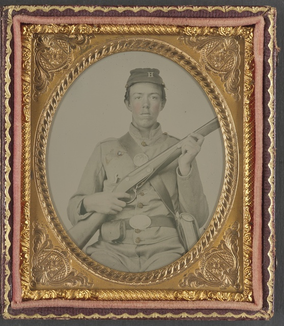 [Unidentified soldier of Co. H, 7th Illinois Infantry Regiment,  in private's uniform with rifle]