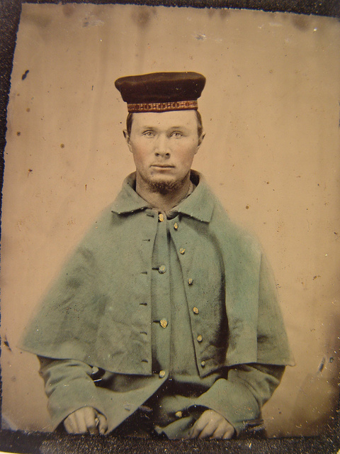 """[Unidentified soldier of the 12th Illinois Volunteers, """"The First Scotch Regiment"""" in greatcoat and tamoshanter cap]"""