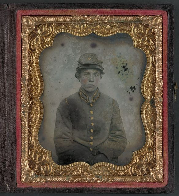 [Unidentified young soldier in Confederate uniform and hat with artillery insignia]