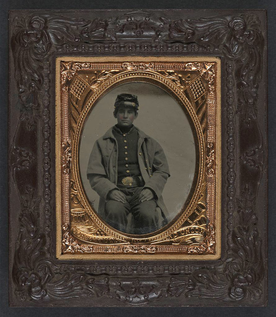 [Unidentified young soldier in Union frock coat and forage cap]