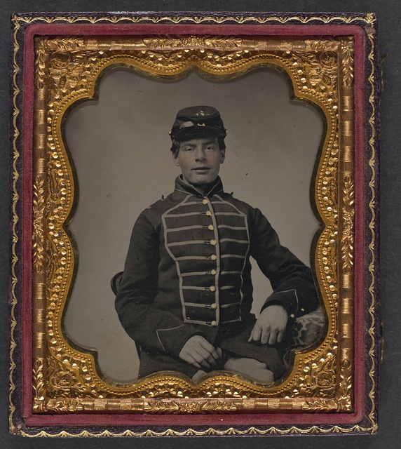 [Unidentified young soldier in Union musician's frock coat with braiding]