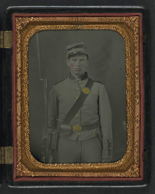 [Unidentified young soldier in Union shell jacket and forage cap with cartridge pouch, haversack, and bayoneted musket ]