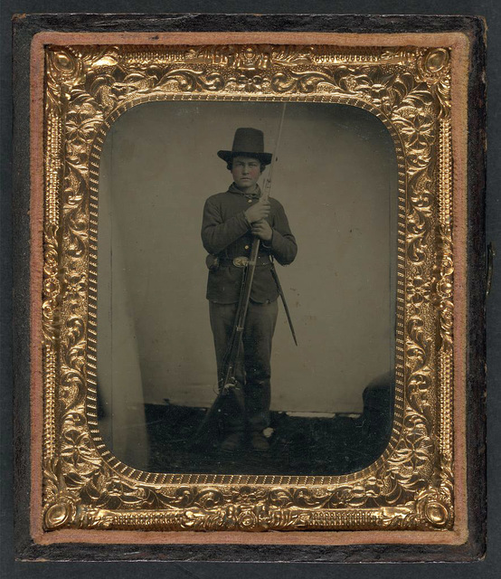 [Unidentified young soldier in Union uniform with bayoneted musket and scabbard]