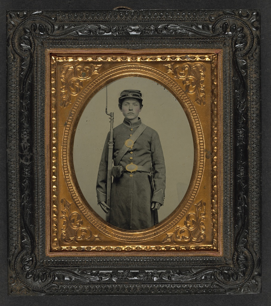 [Unidentified young soldier in Union uniform with bayoneted musket, scabbard, and cap box]