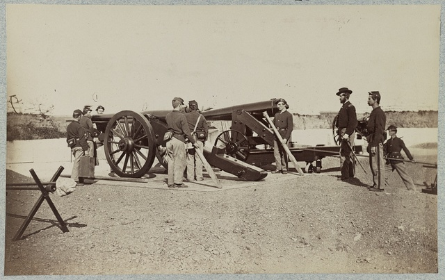 [Union soldiers and three mounted cannons inside a fort]