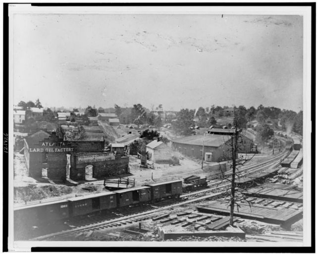 [View of Atlanta, Georgia, with railroad cars in left foreground]