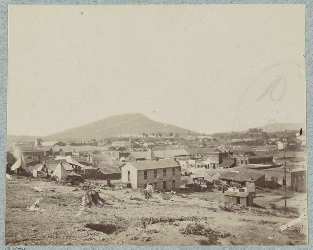 [View of Chattanooga with Lookout Mountain in the distance]