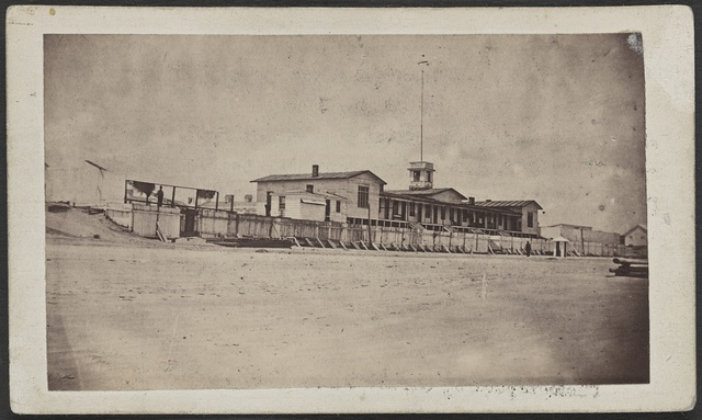 View of the Provost buildings, Hilton Head, S.C. Discription: Built on the bank of the Broad River, (Port Royal Bay.) The rear building for prisoners. The front building for the Provost Marshall General and assistants, as office rooms / / Photographed by G.T. Lape, photographer, 130 Chatham St., N.Y.
