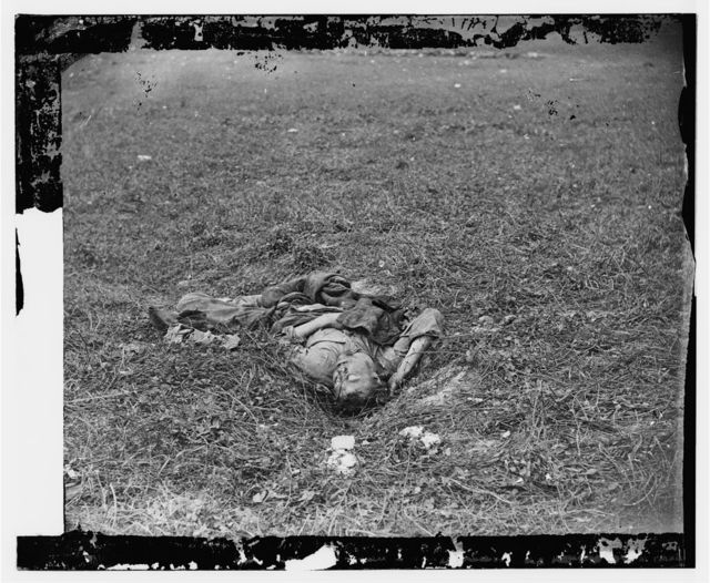 Antietam, Maryland. A Confederate soldier who after being wounded had evidently dragged himself to a little ravine on the hillside where he died