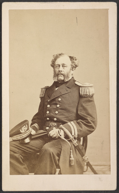 [Commander James H. Strong of U.S.S. Mohawk, Flag, and Monongahela in uniform with sword] / J. Gurney & Son, 707 Broadway, N.Y.