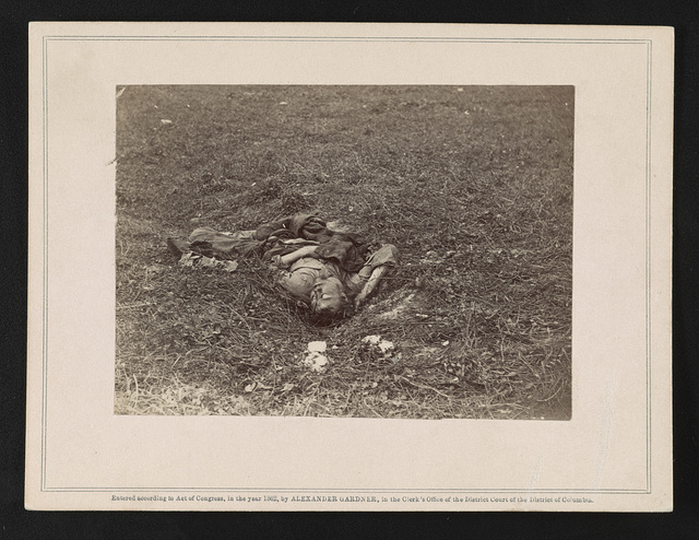 Confederate soldier, who, after being wounded, had dragged himself to a little ravine on the hill-side, where he died