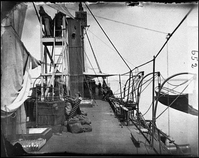 [James River, Va. Deck of iron-clad gunboat Galena, showing stack damaged by fire from Fort Darling, May 15, 1862]