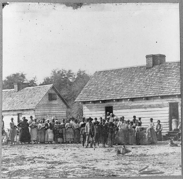 [Large group of slaves(?) standing in front of buildings on Smith's Plantation, Beaufort, South Carolina]