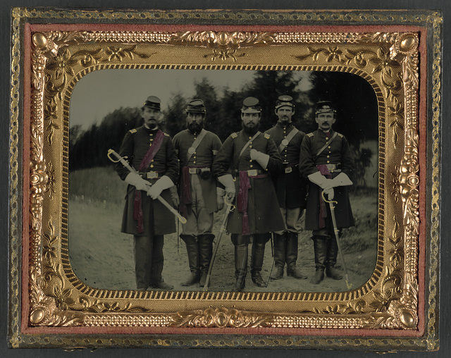 [Lieutenant George W. Mullen, Captain James H. Walter, Lieutenant George W. Wilson, first row, and Sergeant William Cline and Sergent Nicholas G. Wilson, second row, of Co. G, 138th Pennsylvania Infantry Regiment in uniform with swords, at Relay, Maryland]