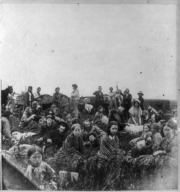 People escaping from the Indian massacre of 1862 in Minnesota, at dinner on a prairie