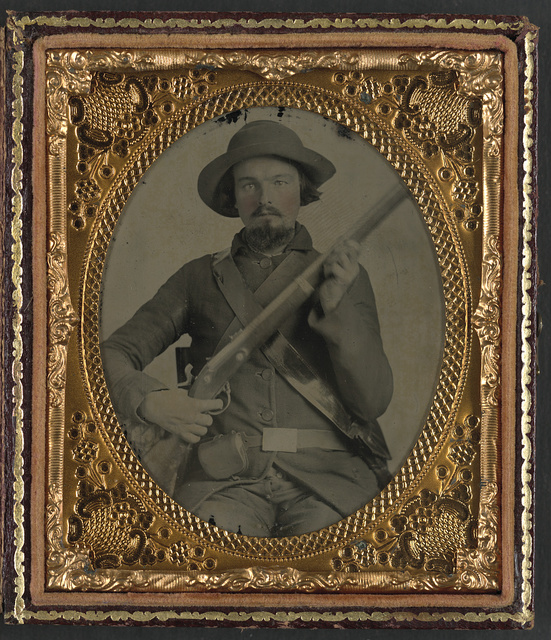 [Private Eliijah S. Leach of Co. B, 31st Virginia Infantry Regiment in uniform with musket, cap box, and haversack]